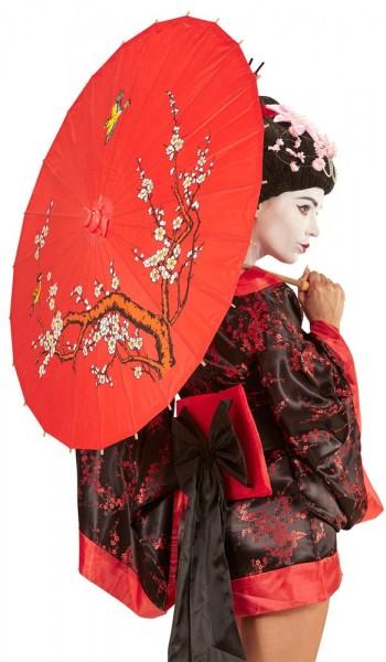 Roter Schirm mit asiatischem Muster
