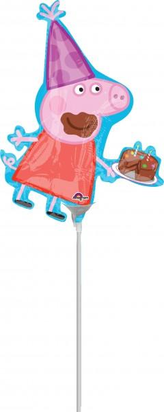 Peppa Pig avec un ballon de bâton de dent sucrée