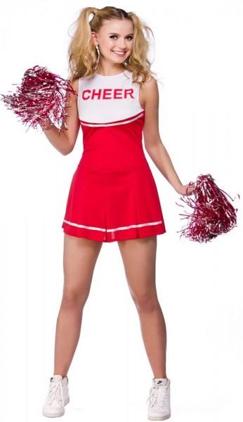 Le cheerleaders rosse e bianche si vestono di pompon