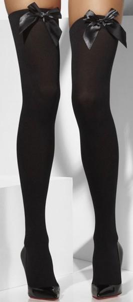 Mooie zwarte dij hoge kousen met strik