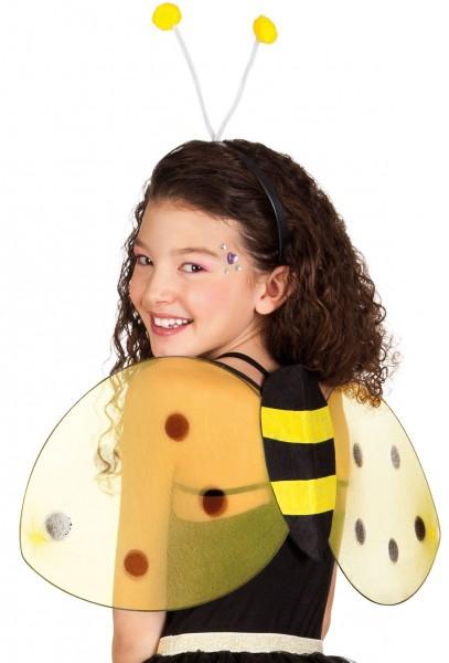 Lindas alas de abejas y diadema para niños.