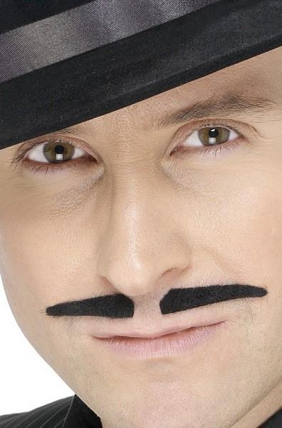 Schwarzer Schurken Schnurrbart