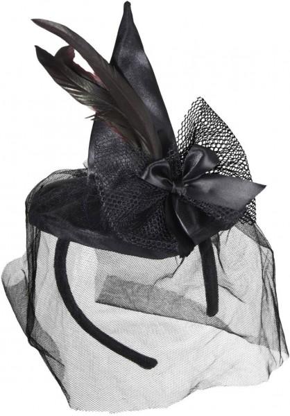 Chapeau de sorcière miniature avec arc et plumes