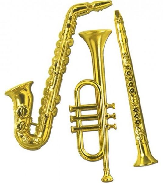 3 golden decorative musical instruments