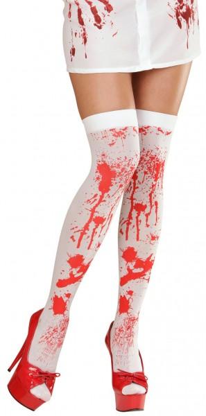Met bloed besmeurde sokken tot over de knie Tessa